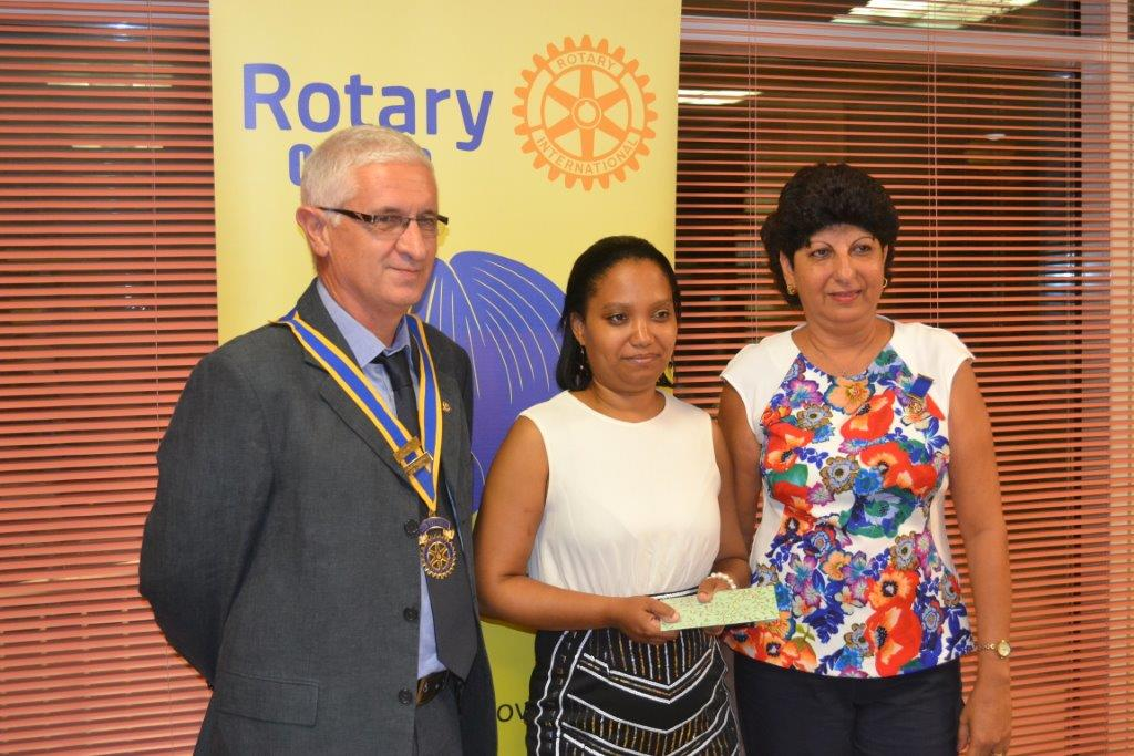 Presenting a donation to a representative of the Ministry of Community Development to assist the shelter for the homeless